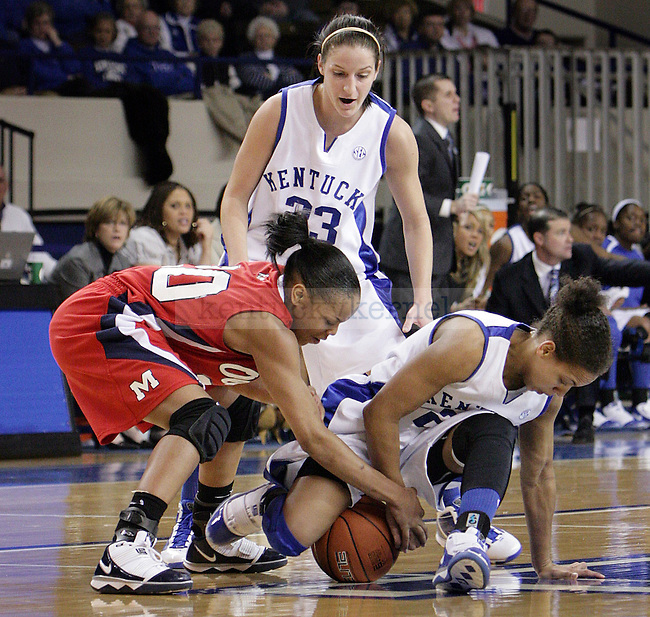 Junior guard Amber Smith fighting for the ball in UK's game against Ole Miss. Photo by William Baldon | Staff