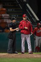 Orem Owlz first baseman Connor Fitzsimons (14) talks with home plate umpire Matt Herrera after Connor Fitzsimons' (not pictured) ejection during a Pioneer League game against the Helena Brewers at Kindrick Legion Field on August 21, 2018 in Helena, Montana. The Orem Owlz defeated the Helena Brewers by a score of 6-0. (Zachary Lucy/Four Seam Images)