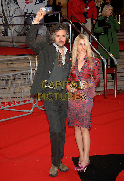 WAYNE COYNE & GUEST.The Brit Awards 2006 - Arrivals,.Earls Court, London, England,.15 February 2006..full length waving earl's pop music brits.Ref: PL.www.capitalpictures.com.sales@capitalpictures.com.©Phil Loftus/Capital Pictures.