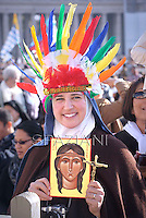 Nun, wearing an Indian headress and holding a painting representing Kateri Tekakwitha, Pope Benedict XVI named today seven new saints, Kateri Tekakwitha of the US, Jacques Berthieu of France, Maria Anna Cope of Germany, Pedro Calungsod from the Philippines, Maria Schaffer of Germany, Giovanni Battista Piamarta of Italy, Maria del Carmen of Spain, in St. Peter square at the Vatican, 21 October, 2012