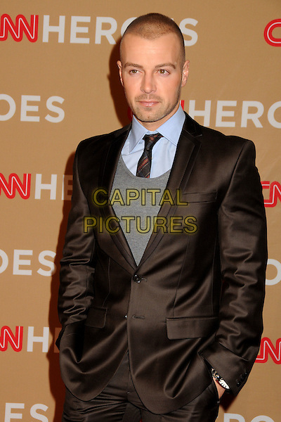 JOEY LAWRENCE .CNN Heroes: An All-Star Tribute 2010 held at the Shrine Auditorium, Los Angeles, California, USA, .20th November 2010..half length brown suit tie hands in pockets grey gray .CAP/ADM/BP.©Byron Purvis/AdMedia/Capital Pictures.
