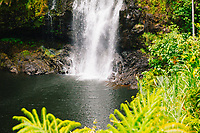 The rope of a rappelling set-up can be seen to the right of Kulaniapia Falls, Big Island of Hawai'i.