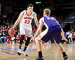SIOUX FALLS, SD: MARCH 4: Tyler Flack #23 from the University of South Dakota looks to make a move against Brandon Gilbeck #52 from Western Illinois on March 4, 2017 during the Summit League Basketball Championship at the Denny Sanford Premier Center in Sioux Falls, SD. (Photo by Dave Eggen/Inertia)