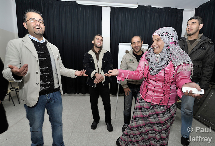 Young people in Gaza participate in a group activity at the Alassria Cultural Center in the Jabalya refugee camp in the Gaza Strip. The center is supported by the American Friends Service Committee, a Quaker organization from the United States. On the left is Adham Khalil, a prominent youth leader...