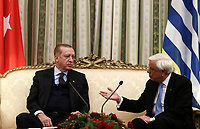 Pictured: Greek President Prokopis Pavlopoulos (R) speaks with Turkey President Recep Tayyip Erdogan in the official Presidential Mansion <br /> Re: Turkey's president Recep Tayyip Erdogan has begun a landmark visit to Greece. Thursday 07 December 2017