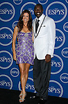 Actress Kate Walsh and NFL player Terrell Owens pose in the press room at the 2008 ESPY Awards held at NOKIA Theatre L.A. LIVE on July 16, 2008 in Los Angeles, California.