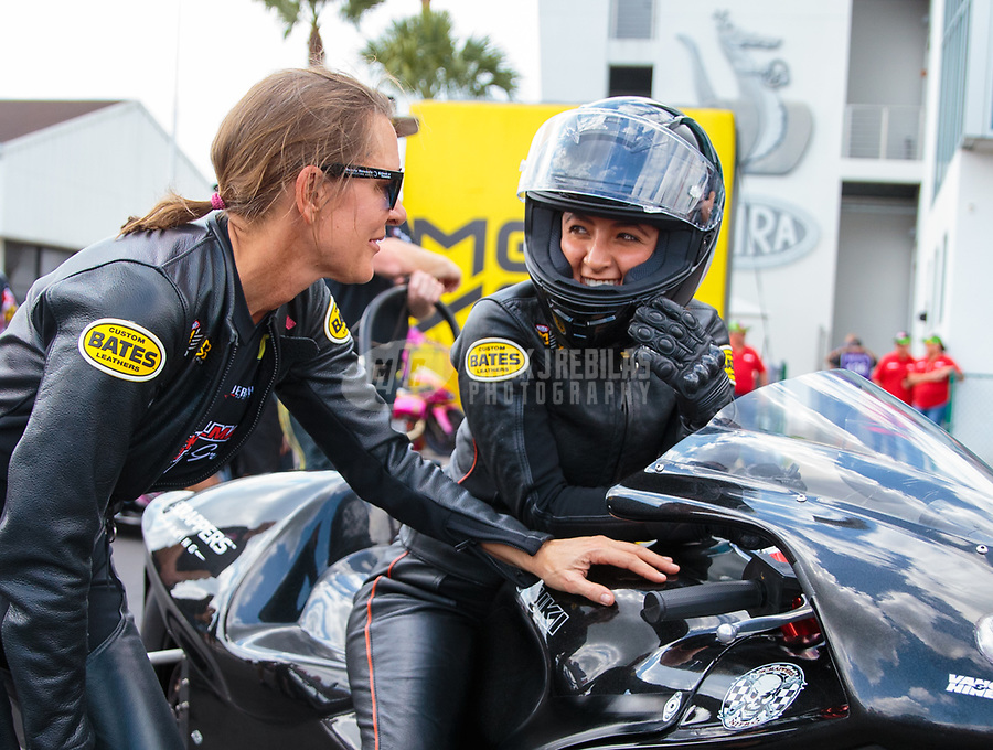 Mar 15, 2019; Gainesville, FL, USA; NHRA pro stock motorcycle rider Jianna Salinas (right) with Karen Stoffer during qualifying for the Gatornationals at Gainesville Raceway. Mandatory Credit: Mark J. Rebilas-USA TODAY Sports