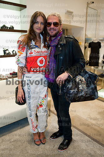 Fashion model Reka Ebergenyi (L) and stylist Mark Lakatos (R) pose for a photograph during the annual Hugo Boss party just prior to the Hungarian F1 Grand Prix in Budapest, Hungary. Thursday, 28. July 2011. ATTILA VOLGYI