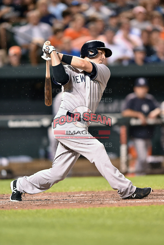 New York Yankees second baseman Stephen Drew #33 swings at a pitch during a game against the Baltimore Orioles at Oriole Park at Camden Yards August 11, 2014 in Baltimore, Maryland. The Orioles defeated the Yankees 11-3. (Tony Farlow/Four Seam Images)
