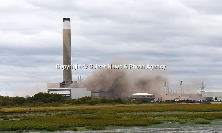 Pictured:  Fawley Power Station during the controlled explosion.<br /> <br /> An iconic power station which has featured in Hollywood films including Star Wars was today destroyed in a controlled explosion.  Fawley Power Station has dominated the Hampshire skyline for almost half a century, and provided the set for films such as 'Mission: Impossible – Rogue Nation' and 'Solo: A Star Wars Story'.<br /> <br /> The main body of the power station, which was decommissioned in 2013, was destroyed today ahead of a proposed £1bn redevelopment scheme.  Demolition contractor Brown and Mason spent the last two years preparing for today's explosion which is the first phase in a two-year plan to demolish the entire site.  SEE OUR COPY FOR DETAILS.<br /> <br /> © Roger Arbon/Solent News & Photo Agency<br /> UK +44 (0) 2380 458800