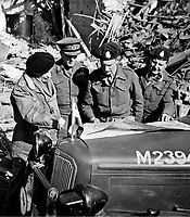 BNPS.co.uk (01202 558833)<br /> NARA/BNPS<br /> <br /> Montgomery (left) stands next to his XXX Corps commander, Brian Horrocks, and other staff officers as they review maps on the hood of a staff car. <br /> <br /> Remarkable rarely seen photos of heroic Allied soldiers fighting their way across Europe before crossing the River Rhine 75 years ago feature in a new book.<br /> <br /> They are published in Images of War, Montgomery's Rhine Crossing, which tells the story of the legendary offensive, nicknamed Operation Plunder, in March 1945.<br /> <br /> On the night of March 23, Field Marshal Bernard Montgomery's 21st Army Group launched a massive artillery, amphibious and airborne assault to breach the historic defensive water barrier protecting northern Germany.<br /> <br /> At the same time, the Americans, with the support of the British 6th Airborne Division, set in motion Operation Varsity - involving 16,000 paratroopers - on the east bank of the Rhine. They were dropped here to seize bridges to prevent German reinforcements from contesting the bridgeheads.<br /> <br /> Fierce fighting ensued, with much bloodshed on both sides as the Allies met determined resistance from machine gun nests. But the daring operation proved successful, helping to considerably shorten the war - the Nazis surrendered just six weeks later.