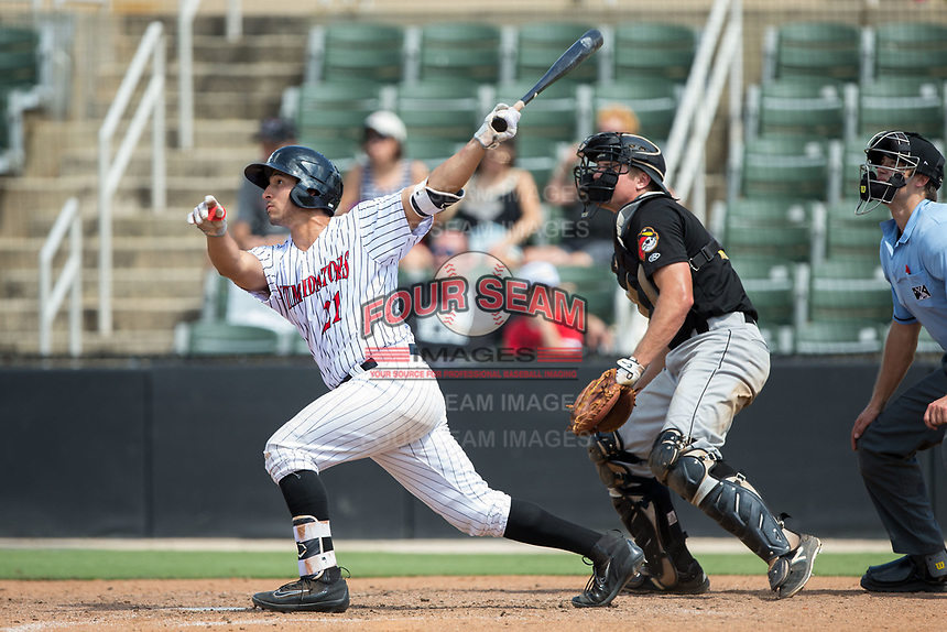 Seby Zavala (21) of the Kannapolis Intimidators follows through on a 3-run home run against the West Virginia Power at Kannapolis Intimidators Stadium on June 18, 2017 in Kannapolis, North Carolina.  The Intimidators defeated the Power 5-3 to win the South Atlantic League Northern Division first half title.  It is the first trip to the playoffs for the Intimidators since 2009.  (Brian Westerholt/Four Seam Images)