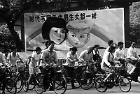 A propoganda poster talks of sexual equality between boys and girls, &quot;In different times, having the boys and girls are the same&quot;. China's one-child policy has created  social disorder and an imbalance in the national birth rate, especially in the countryside where boys outnumber girls by as many as 150:100 born,  Guangzhou, China.<br /> 21 Mar 2001<br /> <br /> photo by Richard Jones / Sinopix