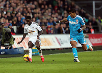 SWANSEA, WALES - FEBRUARY 07: L-R Nathan Dyer of Swansea is closely followed by Patrick Van Aanholt of Sunderland during the Premier League match between Swansea City and Sunderland AFC at Liberty Stadium on February 7, 2015 in Swansea, Wales.