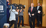 Australian Treasurer Scott Morrison (C) and Finance Minister Mathiass Cormann (R) enter for a press conference in the Budget Lockup at Parliament House in Canberra, Australia, on Tuesday, May 9, 2017.  Photographer: Mark Graham/Bloomberg