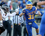 BROOKINGS, SD - OCTOBER 11:  Zach Zenner #31 from South Dakota State looks for room outside a defender from Missouri State in the first half of their game Saturday evening at Coughlin Alumni Stadium in Brookings. (Photo/Dave Eggen/Inertia)