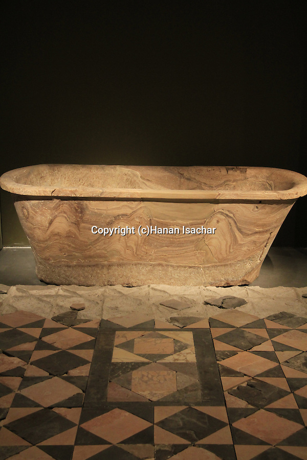 A bathtub and a floor from the bath house at King Herod's palace in Kypros, on display at the Israel Museum