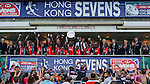 Kenya players celebrate with the trophy after winning the on Shield Final during the Cathay Pacific / HSBC Hong Kong Sevens at the Hong Kong Stadium on 30 March 2014 in Hong Kong, China. Photo by Xaume Olleros / Power Sport Images
