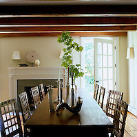 An antique dressmaker's table dominates the dining room