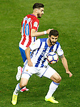 Atletico de Madrid's Yannick Ferreira Carrasco (t) and Real Sociedad's   Raul Navas during La Liga match. April 4,2017. (ALTERPHOTOS/Acero)