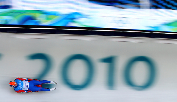Russia's Viktor Kneib slides down the track during the men's luge at the XXI Olympic Winter Games at the Whistler Sliding Center in Whistler British Columbia, Friday, February 12, 2010.