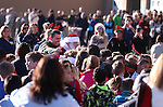Santa greets kids at the 10th annual Holiday with a Hero event at Walmart in Carson City, Nev., on Wednesday, Dec. 17, 2014. The event pairs 200 of Carson City's K-5th grade homeless students with a local heroes for Christmas shopping. <br />