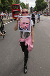 """© Joel Goodman - 07973 332324 . 10/08/2013 . London , UK . A protester walks down the middle of the road in Whitehall with an anti Putin banner . Demonstration against homophobic laws being enacted in Russia on Whitehall this afternoon (10th August 2013) . Legislation includes banning gay pride events for100 years , banning the distribution of """" propaganda of non-traditional sexual relations """" to minors , making it illegal for the adoption of Russian children by gay couples or any single person who comes from a country that recognises marriage equality and giving authorities the rights to arrest foreign nationals whom they suspect are LGBT or pro gay with the right to detain them for up to 14 days. Photo credit : Joel Goodman"""