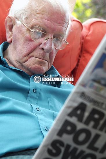 Man reading a newspaper,