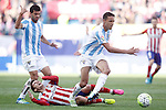 Atletico de Madrid's Antoine Griezmann (c) and Malaga CF's Miguel Torres (l) and Weligton Robson during La Liga match. April 23,2016. (ALTERPHOTOS/Acero)