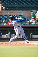 Surprise Saguaros designated hitter Vladimir Guerrero Jr. (27), of the Toronto Blue Jays organization, follows through on his swing during an Arizona Fall League game against the Scottsdale Scorpions at Scottsdale Stadium on October 26, 2018 in Scottsdale, Arizona. Surprise defeated Scottsdale 3-1. (Zachary Lucy/Four Seam Images)