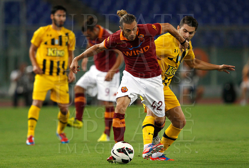 Calcio: partita amichevole Roma-Aris Salonicco. Roma, stadio Olimpico, 19 agosto 2012..AS Roma defender Federico Balzaretti, center, in action during a football friendly match between AS Roma and Aris Thessaloniki, at Rome, Olympic stadium, 19 August 2012..UPDATE IMAGES PRESS/Isabella Bonotto