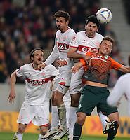 FUSSBALL  1. BUNDESLIGA  SAISON 2011/2012  31. SPIELTAG 13.04.2012 VfB Stuttgart - SV Werder Bremen Tom Trybull (re, SV Werder Bremen) gegen Serdar Tasci (2.v.re., VfB Stuttgart), Martin Harnik (Mitte, VfB Stuttgart)
