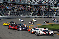 DAYTONA BEACH, FL - JAN 25: The field races in the first turn at the start of the Rolex 24 at Daytona at Daytona International Speedway, Daytona Beach, Florida,  January 25, 2020. (Photo by Brian Cleary/BCPix.com)