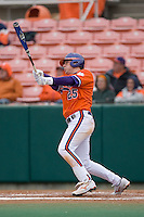 Kyle Parker #25 of the Clemson Tigers follows through on his 2-run home run versus the Wake Forest Demon Deacons at Doug Kingsmore stadium March 13, 2009 in Clemson, SC. (Photo by Brian Westerholt / Four Seam Images)