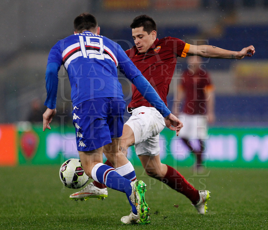 Calcio, Serie A: Roma vs Sampdoria. Roma, stadio Olimpico, 16 marzo 2015. <br /> Roma&rsquo;s Juan Iturbe, right, is challenged by Sampdoria&rsquo;s Vasco Regini during the Italian Serie A football match between Roma and Sampdoria at Rome's Olympic stadium, 16 March 2015.<br /> UPDATE IMAGES PRESS/Isabella Bonotto