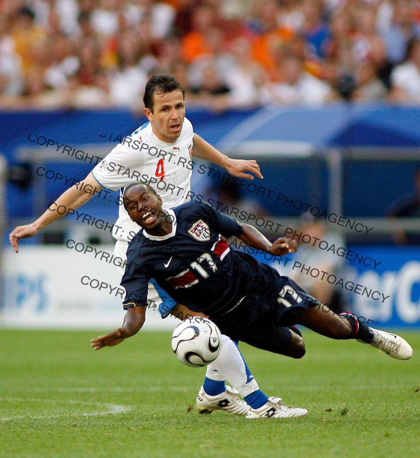 USA's BEASLEY DaMarcus is airborne as Czech Republic Galasek Thomas looks on during the World Cup, Group E soccer match between United States and the Czech Republic, at the Gelsenkirchen stadium, Germany, Monday, June 12, 2006. The other teams in Group E are Italy and Ghana