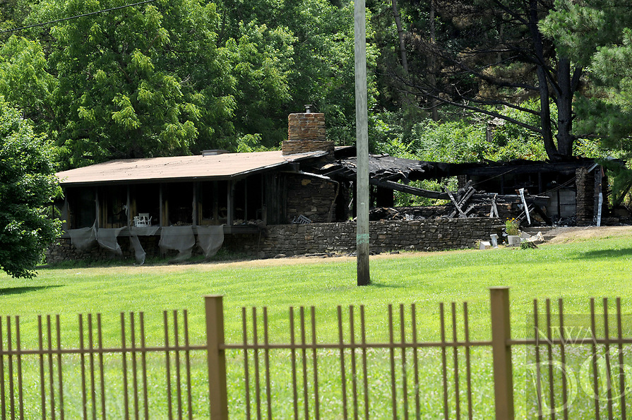NWA Democrat-Gazette/ANDY SHUPE<br /> A Fay Jones-designed house at 6725 E. Huntsville Rd. in Fayetteville that burned early Thursday morning was once home to Bill and Hillary Clinton.
