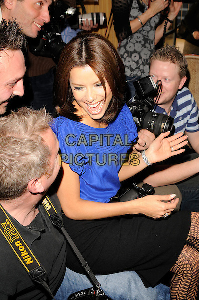 "EVA LONGORIA.Photocall for ""Over Her Dead Body"", Claridges, London, England..January 24, 2008.half length black skirt purple blue top blouse sitting belt photographers mouth open laughing.CAP/CAN.©Can Nguyen/Capital Pictures"