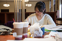 Eliza (Shuyi) Chen studies for her Chemistry final. Students study for finals in the Academic Commons, Dec. 12, 2014. (Photo by Marc Campos, Occidental College Photographer)