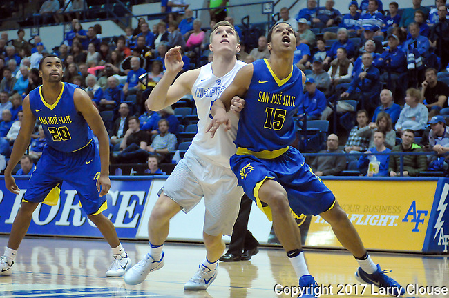 January 14, 2017:  San Jose State's, Brandon Clarke #15, battles Falcon, Zach Kocur #5, for rebound position during the NCAA basketball game between the San Jose State Spartans and the Air Force Academy Falcons, Clune Arena, U.S. Air Force Academy, Colorado Springs, Colorado.  San Jose State defeats Air Force 89-85.