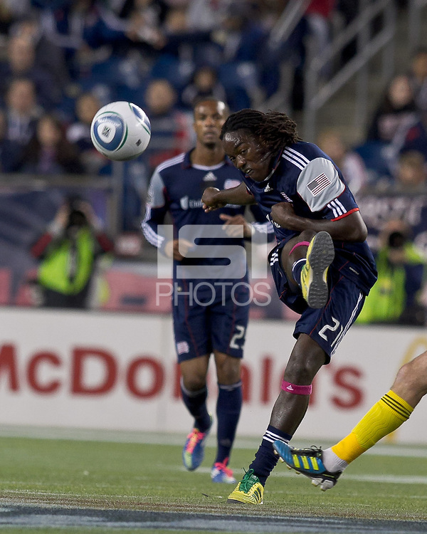 New England Revolution midfielder Shalrie Joseph (21) passes the ball.  In a Major League Soccer (MLS) match, the Columbus Crew defeated the New England Revolution, 3-0, at Gillette Stadium on October 15, 2011.
