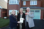 Kay Lavender the first resident at Redrow Homes Mon Bank development in Newport receives the keys to her new home and a card from Mayor of Newport Councillor Cliff Suller and his wife Christine.<br /> 04.12.13<br /> &copy;Steve Pope-FOTOWALES