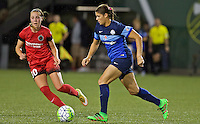 Portland, Oregon - Saturday July 9, 2016: FC Kansas City defender Brittany Taylor (13) controls the ball in front of Portland Thorns FC midfielder Celeste Boureille (30) during a regular season National Women's Soccer League (NWSL) match at Providence Park.