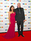 Rosie Perez and guest arrive for the formal Artist's Dinner honoring the recipients of the 38th Annual Kennedy Center Honors hosted by United States Secretary of State John F. Kerry at the U.S. Department of State in Washington, D.C. on Saturday, December 5, 2015. The 2015 honorees are: singer-songwriter Carole King, filmmaker George Lucas, actress and singer Rita Moreno, conductor Seiji Ozawa, and actress and Broadway star Cicely Tyson.<br /> Credit: Ron Sachs / Pool via CNP