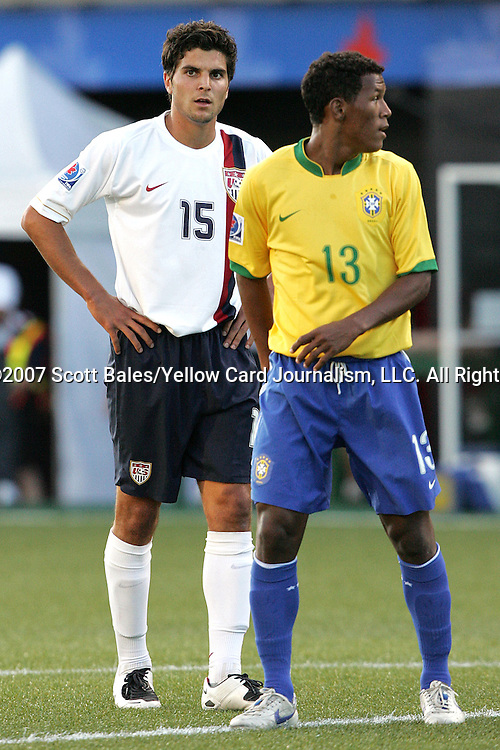 06 July 2007: USA's Sal Zizzo (15) and Brazil's Amaral (13). The Under-20 Men's National Team of the United States defeated Brazil's Under-20 Men's National Team 2-1 in a Group D opening round match at Frank Clair Stadium in Ottawa, Ontario, Canada during the FIFA U-20 World Cup Canada 2007 tournament.