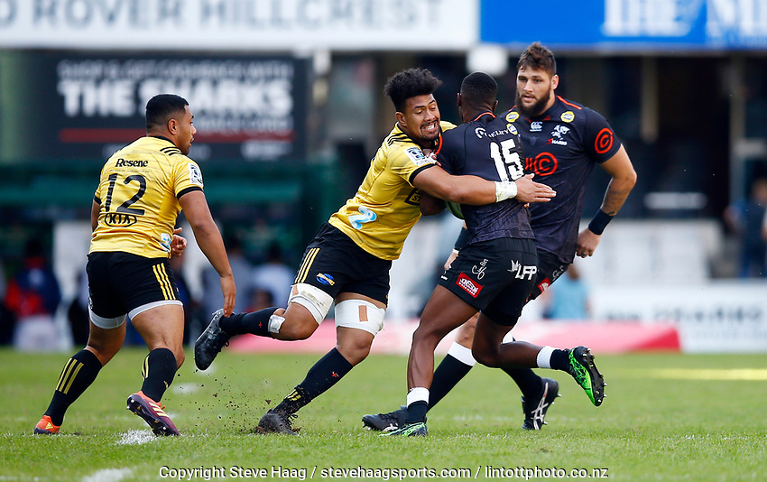DURBAN, SOUTH AFRICA - JUNE 01: Ardie Savea of the Hurricanes tackling Aphelele Fassi of the Cell C Sharks during the Super Rugby match between Cell C Sharks and Hurricanes at Jonsson Kings Park Stadium in Durban, South Africa on Saturday, 1 June 2019. Photo by Steve Haag / stevehaagsports.com