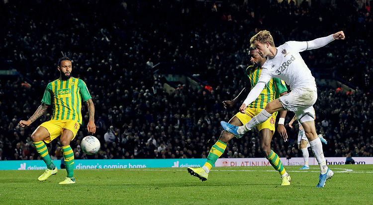 Leeds United's Patrick Bamford shoots from close range despite the attentions of West Bromwich Albion's Semi Ajayi<br /> <br /> Photographer Rich Linley/CameraSport<br /> <br /> The EFL Sky Bet Championship - Tuesday 1st October 2019  - Leeds United v West Bromwich Albion - Elland Road - Leeds<br /> <br /> World Copyright © 2019 CameraSport. All rights reserved. 43 Linden Ave. Countesthorpe. Leicester. England. LE8 5PG - Tel: +44 (0) 116 277 4147 - admin@camerasport.com - www.camerasport.com