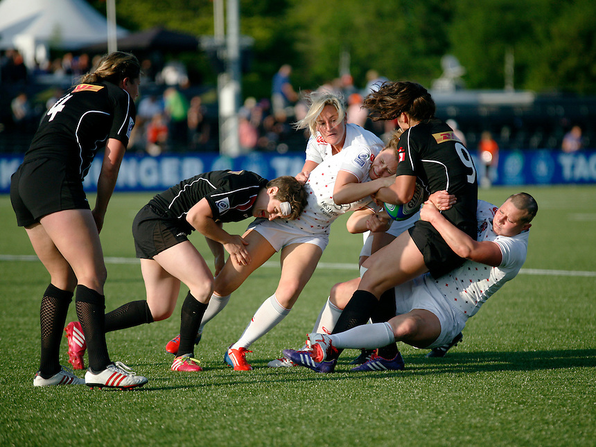 Sarah McKenna and Heather Fisher tackle Bianca Farella. IRB WSWS Amsterdam 7s Day 1 at National Rugby Centre, Amsterdam, Netherlands on 16th May 2014