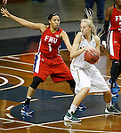 SIOUX FALLS MARCH 22:  Alysha Devine #15 of Alaska Anchorage looks for a way around Victoria Dye #1 of Francis Marion during their quarterfinal game at the NCAA Women's Division II Elite 8 Tournament at the Sanford Pentagon in Sioux Falls, S.D.  (Photo by Dick Carlson/Inertia)
