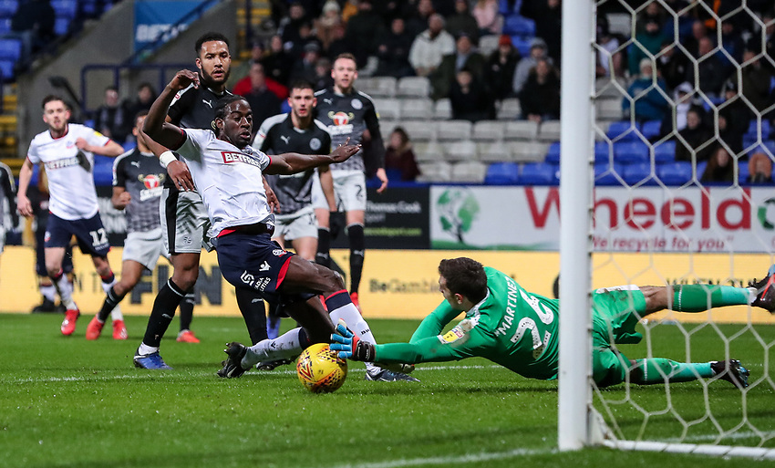 Bolton Wanderers' Clayton Donaldson competing with Reading's Emiliano Martinez  <br /> <br /> Photographer Andrew Kearns/CameraSport<br /> <br /> The EFL Sky Bet Championship - Bolton Wanderers v Reading - Tuesday 29th January 2019 - University of Bolton Stadium - Bolton<br /> <br /> World Copyright © 2019 CameraSport. All rights reserved. 43 Linden Ave. Countesthorpe. Leicester. England. LE8 5PG - Tel: +44 (0) 116 277 4147 - admin@camerasport.com - www.camerasport.com